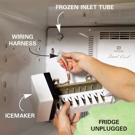 <b>Photo 1: Remove the icemaker</b></br> Remove the screws that hold the icemaker in place. Unplug the wiring harness and remove the icemaker to expose the water inlet tube.
