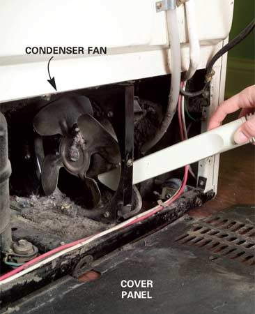 <b>Photo 13: Vacuum the fan</b></br> Pull out the fridge and unscrew the cover panel. Vacuum the fan. Then start the refrigerator to make sure the fan turns freely.