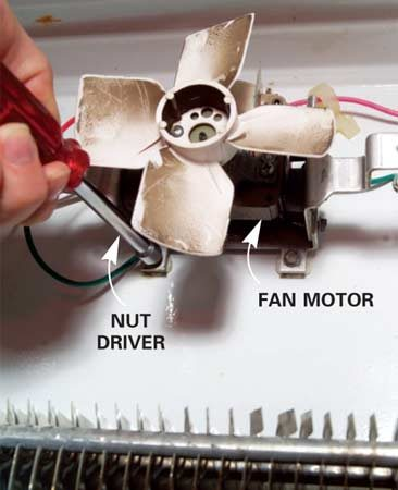 <b>Photo 14: Remove the fan</b></br> Unscrew the fan from the rear wall of the freezer and unplug the wires. With some models, you'll need a socket set or nut driver to remove the fan.