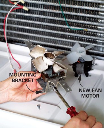 <b>Photo 15: Replace the old fan</b></br> Remove the fan motor from its mounting bracket. Fasten the new fan to the mounting bracket, reconnect the wires and screw the new fan into place.