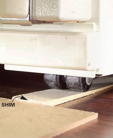 Shim ramps wheel up onto hardboard