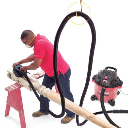 <b>Install a ceiling hook</b></br> Get the hose up and out of the way with a hook attached to the ceiling. It's safer for you and the hose.