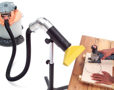 <b>Use a portable collector</b></br> A dust shroud can be set near a saw, drill or sander and pick up dust as you work.