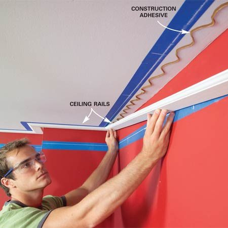 <b>Photo 4: Install the ceiling rails</b></br> Glue the ceiling rails into place with construction adhesive. Nail the rails to joists wherever possible. Where you can't hit ceiling joists, drive nails into the drywall at a 45-degree angle. Angled nails will hold the rails in place until the adhesive sets.