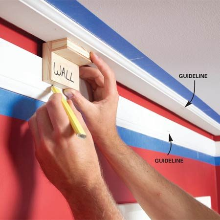 <b>Photo 7: Mark the rails</b></br> Mark the position of the crown molding's edges on the rails using your gauge. Place guidelines at all corners and every 2 ft. along walls. Use the marks to position the crown.
