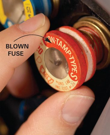 <b>Detail of a blown fuse</b></br> <p>Replace burned-out fuses. Look inside the fuse for charred glass or a broken filament—evidence of  a blown fuse. Unscrew the suspect fuse and replace it with one of the same type  and amperage. </p>