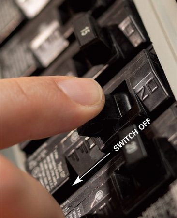 "<b>Photo 3: Resetting the breaker</b></br> <p>The  first step in resetting a tripped breaker is to switch it off. Don't just flick  the handle; press the handle firmly to the ""off"" position. You should hear a  click.</p>"
