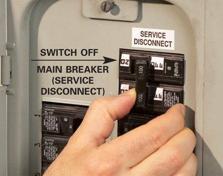 <b>Photo 1: Turn off the main breaker</b></br> First make sure all computers are turned off and everyone in the house knows you'll be turning off the power. Then switch off the main circuit breaker. Keep a flashlight handy because all the lights will go out.
