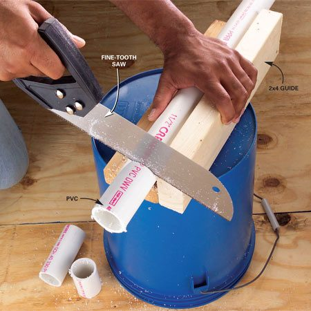 <b>Photo 1: Cutting plastic pipe</b></br> Get clean, square cuts with a fine-tooth saw and a homemade guide.