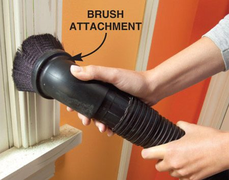 <b>Vacuum the woodwork</b></br> Dust off the woodwork, then vacuum it with a brush attachment.