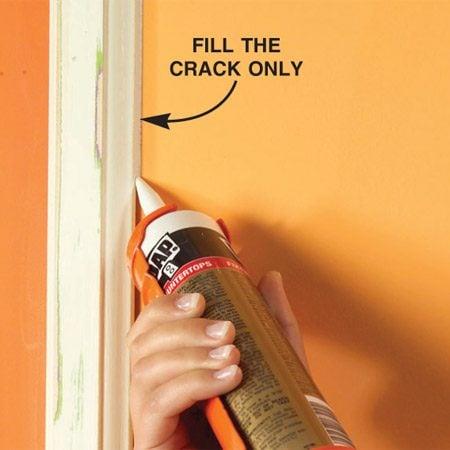 <b>Caulk along the trim</b></br> Run a crisp bead of caulk between the trim and the wall.