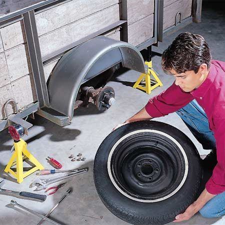 <b>Photo 1: Remove the wheel</b></br> Remove the lug nuts and the wheel. Be sure that the trailer is supported with jack stands and the opposite wheel is blocked.
