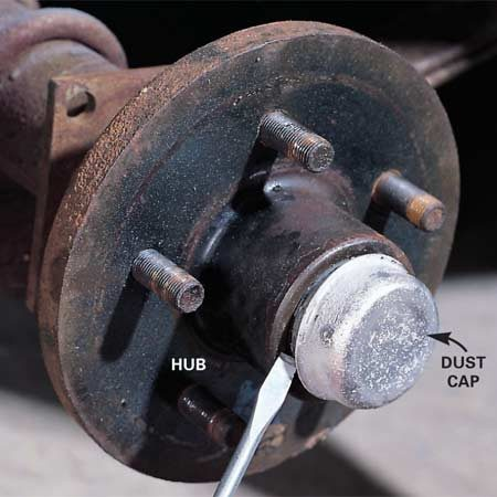 <b>Photo 2: Remove the dust cap</b></br> Pry the dust cap loose with a large screwdriver.