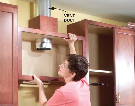 <b>Photo 3: Take out the cabinet</b></br> Remove vent sections if necessary, then slide the cabinet free of the vent and set it aside.