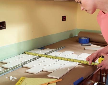 <b>Photo 4: Decide on a layout</b></br> Lay out a section of the countertop design with the tile spacers. Take accurate measurements of sections of the tile to determine the best starting and ending points. You may have to shift your design from side to side or up and down a bit to avoid unsightly small pieces at the ends.