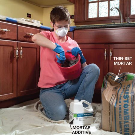 <b>Photo 6: Mix the mortar</b></br> Mix about 1 to 1-1/2 quarts of thin-set mortar to a toothpaste consistency. Don't mix more than you can use in about 30 minutes of working time.
