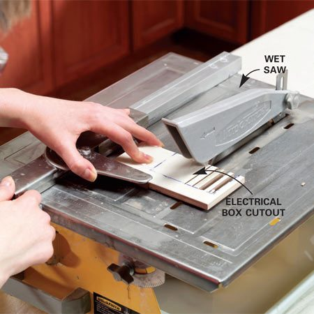 <b>Photo 9: Rough cut electrical boxes</b></br> Trapped cutouts, like this electrical box contained within a single tile, require multiple cuts every 1/2 in. across the tile.