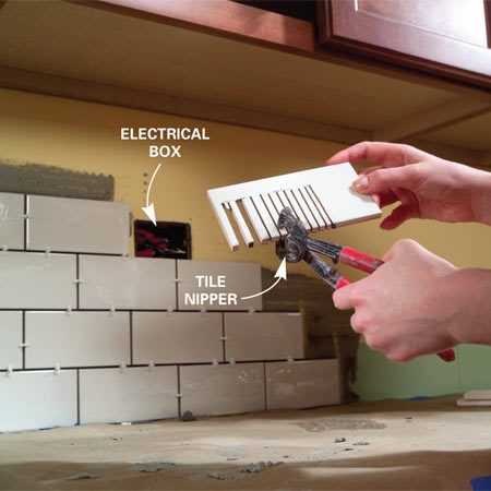 <b>Photo 10: Finish the cut</b></br> Break the tile strips away using a tile nipper. Try not to remove too much at a time or you could break the piece at the wrong spot.