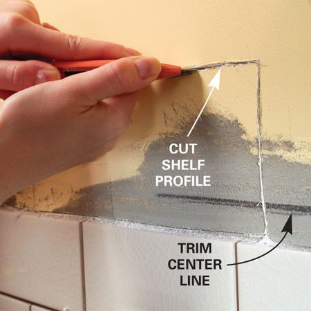 <b>Photo 4: Remove the drywall</b></br> Cut out the drywall along your traced outline using a new blade in your utility knife, making several passes.