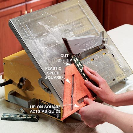 <b>Photo 7: Cut the corner trim pieces</b></br> Cut your mitered trim pieces at a 45-degree angle at the corners for a finished look. We used a square to feed the tile into the saw.