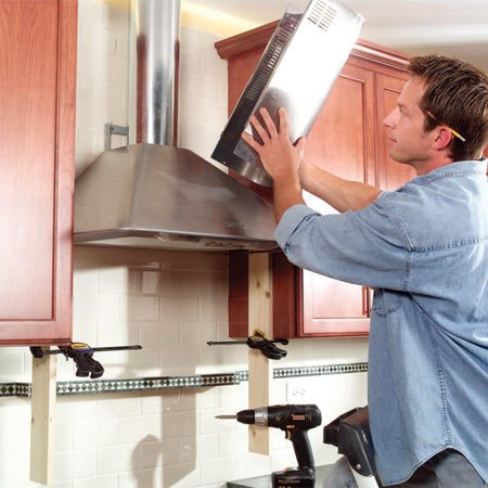 <b>Photo 15: Install the range hood</b></br> Install your new range hood following the manufacturer's instructions.