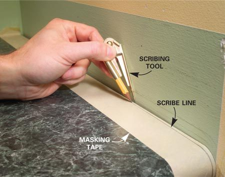 <b>Photo 5: Scribe the end</b></br> Measure the distance the miter extends into the hole, subtract 1/4 in. and set the scribing tool to this dimension. Scribe a line parallel to the end wall.