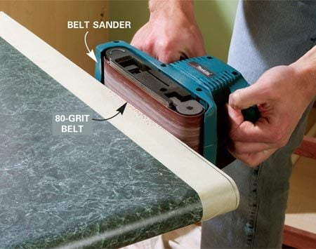 <b>Photo 6: Sand to the line</b></br> Sand to the line with a belt sander. Set the top in place to check the fit. Make sure the front edge of the countertop is parallel to the face of the cabinets.