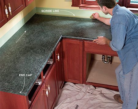 <b>Photo 10: Subtract the overhang from the opposite countertop</b></br> Scribe a line on the backside of the countertop opposite the end cap. Remove the tops and sand to the line with a belt sander. Set the tops back in place and check the fit to the wall and the end cap overhang.