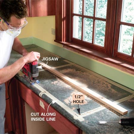 <b>Photo 2: Cut the sink opening</b></br> Drill a 1/2-in. starting hole in each corner and cut out the sink opening with a jigsaw and fine woodcutting blade. Screw a strip of wood to the cutout to prevent it from falling in when you complete the cut.