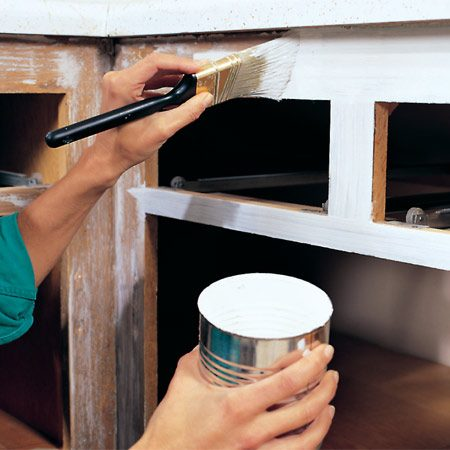 <b>Priming old cabinets</b></br> A careful sanding and good primer set the stage for a smooth, durable top coat.