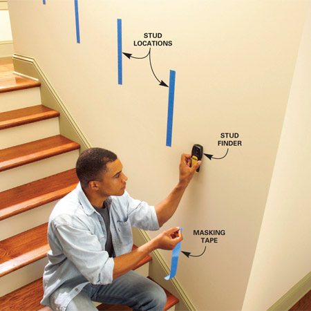 <b>Photo 1: Locate the studs</b></br> Locate the studs in the wall above the stairs. Use a stud finder and mark the locations with strips of 1-1/2 in. masking tape centered about 36 in. above the stairs.