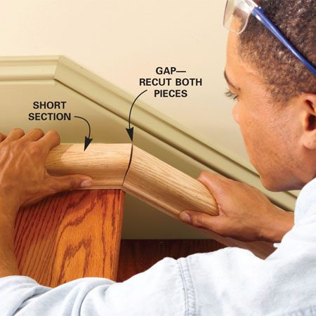 <b>Photo 5: Test the fit</b></br> Test the fit of the rail joint. Adjust the cutting angle and recut both pieces until the joint is tight. Then cut a 45-degree miter on the other end of the short piece, allowing enough length to reach the next stud.