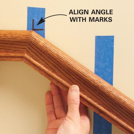 <b>Photo 7: Close-up</b></br> Align the railing with the joint mark on the wall.