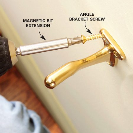 <b>Photo 11: Screw the bracket to the wall</b></br> Remove the masking tape and screw the bracket to the wall. Angle the top screws slightly to follow the angled pilot holes.