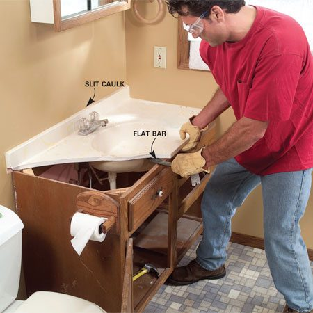<b>Photo 1: Remove the vanity top</b></br> Shut off the main water supply valve and disconnect the water and drain lines. Slit any caulk between the backsplash and wall, then pry the top free of the vanity.