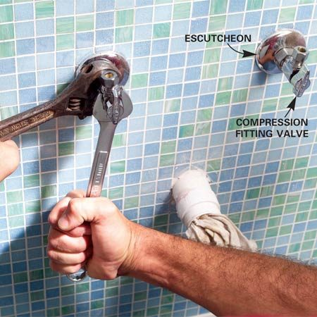 <b>Photo 10: Install the shut-off valves</b></br> Cut the water supply lines 1 in. beyond the finished wall. Slip escutcheons over the lines and snug up but don't fully tighten the compression fitting valves.