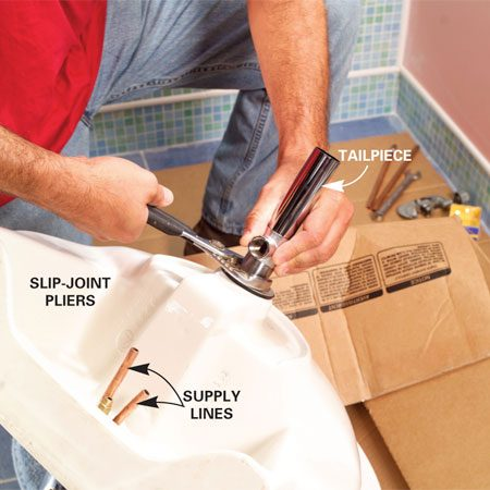 <b>Photo 11: Mount the faucet and drain first</b></br> Trim back the faucet supply lines to about 7 and 8 in. Then install the faucet and sink tailpiece following the manufacturer's instructions.