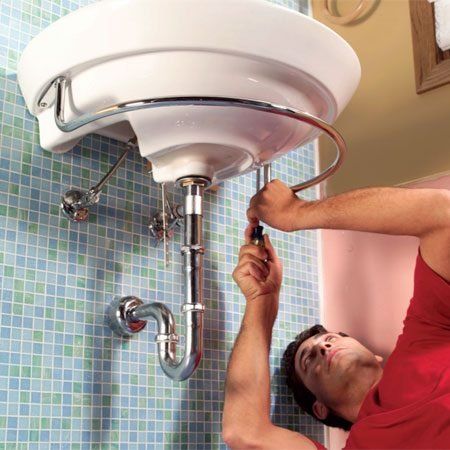 <b>Photo 18: Tighten and check for leaks</b></br> Align all of the drain assembly parts and tighten the nuts. Then install sink accessories.