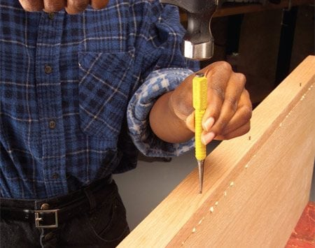 Use a nail set to drive the nail heads below the<br/> surface.