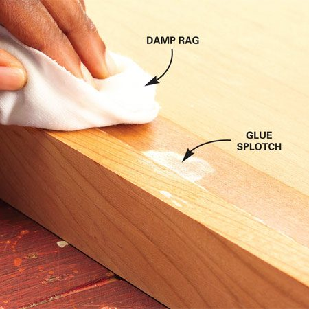 <b>Photo 6: Find and remove glue spots </b></br> Moisten the surface with a damp rag to reveal dried glue smudges. Scrape them off while they're wet. Let the glue set another hour.