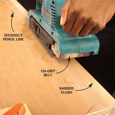 <b>Photo 7: Lightly sand the nosing</b></br> Scribble a pencil line along the length of the plywood, overlapping it onto the nosing. Carefully sand the nosing with a belt sander and 120-grit belt until the pencil line disappears and the nosing is flush to the plywood.