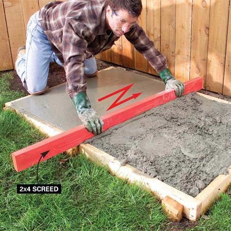 <b>Photo 1: Screed the concrete</b></br> Push or pull the screed board across the forms with a back-and-forth sawing motion. Shove concrete into low spots in front of the screed board. Repeat to remove excess concrete.