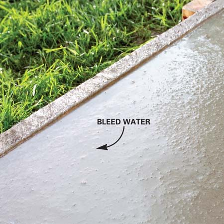 "<b>Photo 3: Wait for the surface water to disappear</b></br> Water will appear on the surface. Wait until this ""bleed"" water and sheen disappear entirely before edging, jointing or floating the concrete."