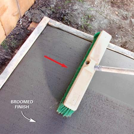 <b>Photo 8: Create a non-slip surface</b></br> Drag a broom across the concrete after floating it with the magnesium float to create a non-slip surface. Adjust the downward pressure to create the desired amount of texture.