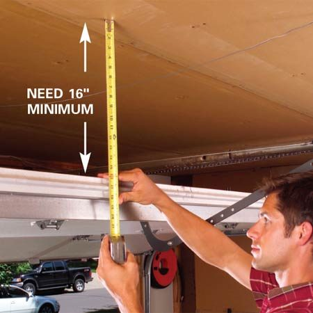 <b>Photo 1</b></br> Measure from the ceiling to the top of the raised garage door. Subtract 1 in. to determine the height of the side 2x4s.