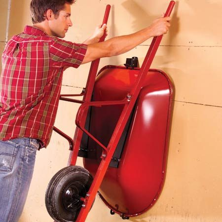 <b>On-the-wall wheelbarrow storage</b></br> Two brackets are all it takes to store your wheelbarrow.