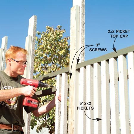 <b>Photo 8: Attach the pickets</b></br> Cut the 2x2 picket top caps to length and screw them to the 2x6 posts. Then push the pickets against the top cap and screw them to both rails using your layout marks as a guide.