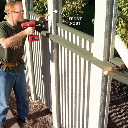 <b>Photo 9: Set the front posts in the precut notches</b></br> Attach the front cedar 2x6 posts using the precut notches in the front top rail as a guide. Secure them with 3-in. screws every 6 in.