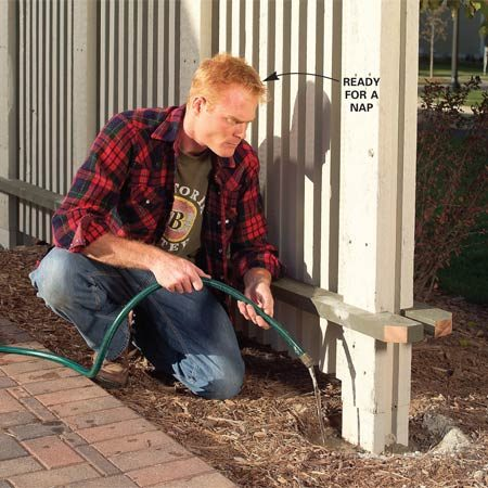<b>Photo 13: Fill the dry concrete holes with water</b></br> Fill the holes with water and let the panel sit overnight. Remove the braces and touch up raw wood and screws with finish.