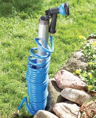 <b>Hook hose nozzle onto the pipe end</b></br> This hose holder's narrow profile is both space saving and attractive.
